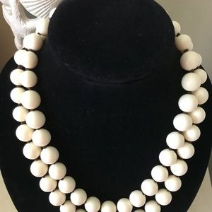 Double strand ivory colored beaded necklace